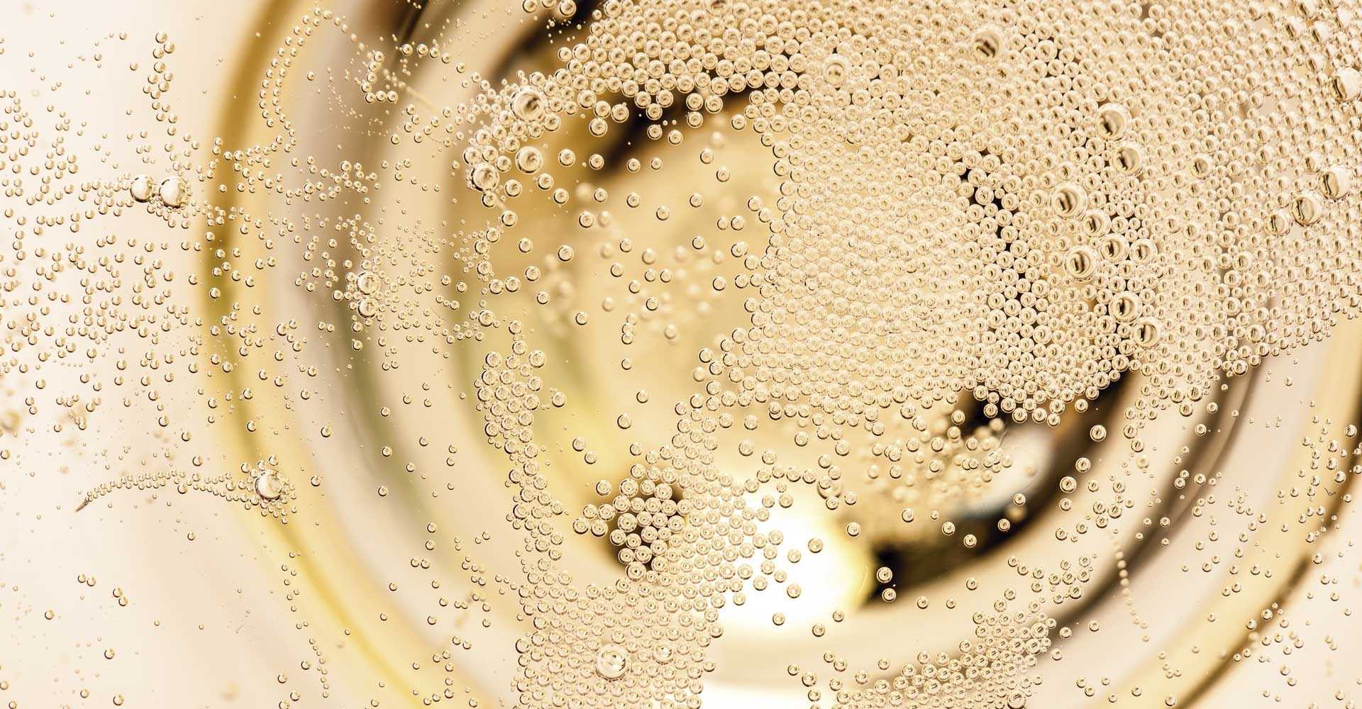 Texto: as bolhas presentes no champagne são chamadas de perlage.